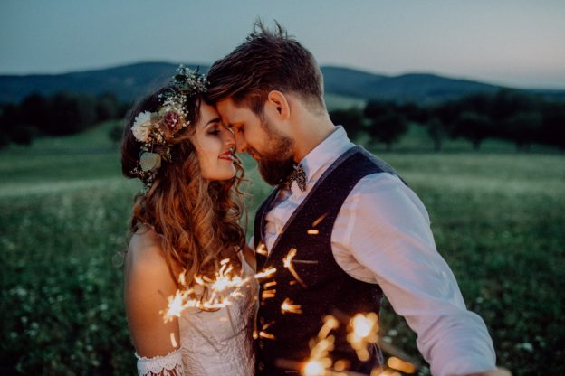 Boho bride and groom with Wedding sparklers