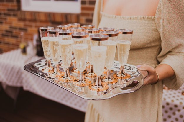 Tray of champagne glasses at holiday party